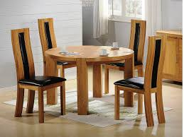simple dining space design with round wood dining table sets