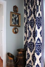 Ikat curtains, navy & white - living room. love the greek key trim.