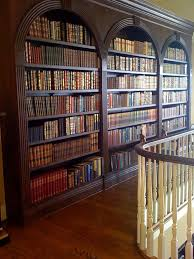 turn wasted space into a home library space bookcase book shelf library bookshelf read office