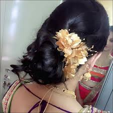south indian bridal hairstyles for receptions chignon with minimal flowers