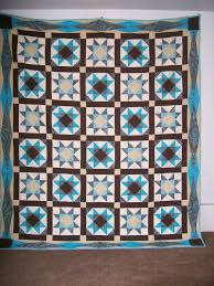 Queen size Ohio star quilt with turquoise brown and cream & Like this item? Adamdwight.com