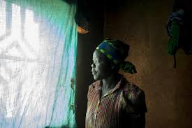 growing up in rwanda a photo essay vso w in profile looks throw a window in rwanda vso