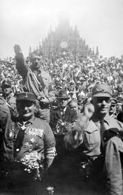 hermann goring  goring left stands in front of hitler at a nazi rally in nuremberg c 1928
