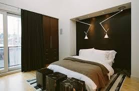 chic masculine bedroom design round grey fur rug wooden polish frame bed black leather furniture teak wood stained frame bed grey bedding sets bedding for black furniture