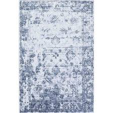 picture of distressed vintage blue rug