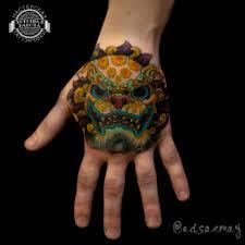 тату в японском стиле на кисти руки фото татуировок