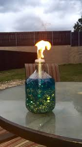 DIY Tiki Torch! I placed beads in the bottle of an apple cider bottle,