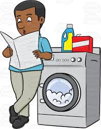 black man washing clothes. Brilliant Black A Black Man Kills Time By Reading Newspaper While Waiting For His Laundry  To Finish  With Black Man Washing Clothes G