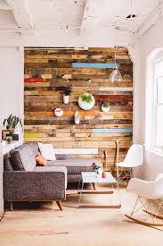 colorful reclaimed wooden accent wall white painted wall white rocking chairs coffee table
