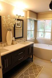 Warm toned #bathroom with furniture-style vanity. Visit Devine Bath's  website for more
