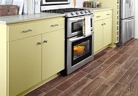 wood floor tile in kitchen light tone planks of wood look tile flooring in a