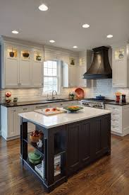 we especially love how the black of the island sink echoes the color of the granite countertops using the same white cabinetry throughout keeps the look