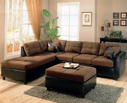 dark brown fabric sofa and glass windows also brown fabric ottoman