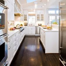 kitchens with white cabinets and dark floors. Black Sink And Curved Faucet Beige Tile Ceramic Flooring Wood Floor In Kitchen Dark Kitchens With White Cabinets Floors