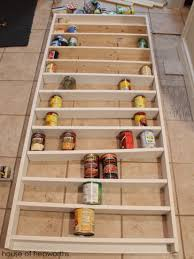laying out the shelves using cans