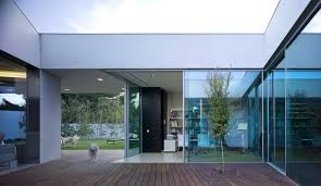 large glass window wooden floor and sliding glass