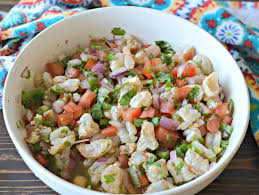 mixing the shrimp ceviche in a large bowl