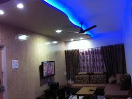 False ceiling lighting Spot Ornate Modern Pop Ceiling Designs With Blue False Ceiling Lighting Views Over Minimalist Family Room Decors Designs Kirin Design Studios Ornate Modern Pop Ceiling Designs With Blue False Ceiling Lighting