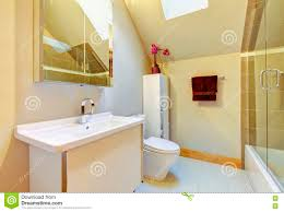 small beige bathroom with shower toilet and vaulted ceiling bathroom shower toilet