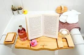 wooden bath over bathtub shelf with a wine glass book holder floating rack