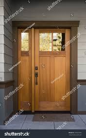Natural Wood Front Door On Grey Stock Photo  Shutterstock - Exterior doormat