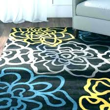 gray yellow rug blue grey area and couch gray yellow rug