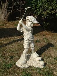 garden statue of boy playing golf