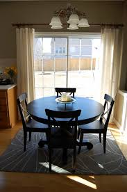 interesting furniture for dining room decoration using round pedestal black wood dining table top notch