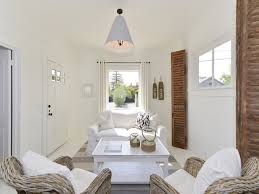 white interior paintSmall Cottage with Coastal White Interiors  Home Bunch  Interior