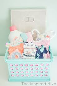 darling diy laundry basket baby shower gift basket idea via the inspired hive do it