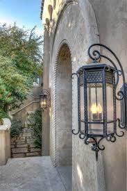 a distinctive spanish colonial revival residence elegant residences outdoor lanternoutdoor lightingwall