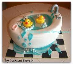 this bathtub cake was designed for a baby shower with a rubber ducky theme