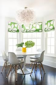 Stunning Contemporary Dining Room Features An Eye Catching Oly Studio Muriel  Chandelier Hung Over A Saarinen Dining Table Seating Five Eames Molded  Plastic ...