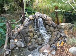 commercial and residential koi pond builders in pinellas county fl custom waterfalls and streams koi pond maintenance koi pond services koi for