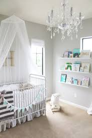 girl room lighting. Crystal Chandelier Lighting And Baby Girl Room Also Rectangular Crib Bed Floating Wall Shelves With Lip Animal Rocking Chair