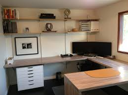 small modern home office design with floating butcher block computer desk plus mounted bookshelf and funiture shelf plus white file cabinet ideas
