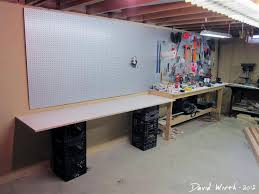 arts and crafts area with work area in basement