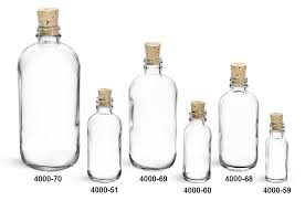 glass bottles clear glass boston rounds w cork stoppers
