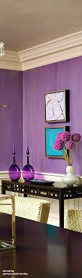 This purple accent wall adds a nice piece of color to the room without  being too