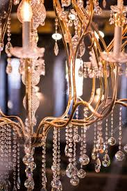 close up of luxurious crystal chandelier from fancy restaurant photo by photographee eu