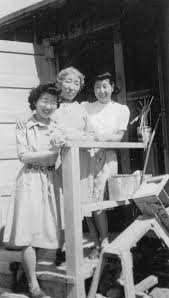 photo essay ten portraits of mothering in wwii ese american  shigeko kitamoto and her children left to right s jane frank and lilly kitamoto in front of their barracks at the minidoka concentration camp