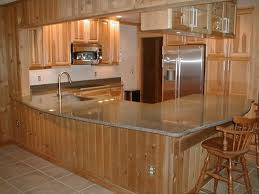 zodiaq black forest quartz counter tops with hickory cabinets