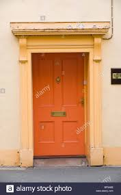 Orange front door Nepinetwork Orange Painted Wooden Paneled Front Door No 96 With Brass Letterbox And Flat Pediment And Architrave Of Town House In Uk Contractorculture Orange Painted Wooden Paneled Front Door No 96 With Brass Letterbox