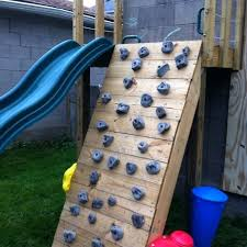 diy rock climbing wall family climbing wall build this spring next to our slide kids will diy rock climbing wall