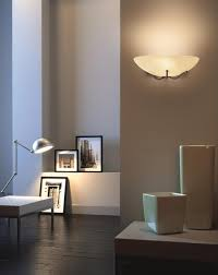 Wall lighting effects Mood Classic Wall Mounted Uplighter Offering Ambient Wall Washed Lighting Effects Featuring Half Bowl Shaped Scavo Glass Diffuser And Decorative Base Finial Christopher Wray Christopher Wray Dansa Wall Light Christopher Wray Lighting