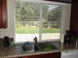 amazing kitchen pass through window ideas with horizontal window blinds also under mount stainless steel sink plus marble countertop