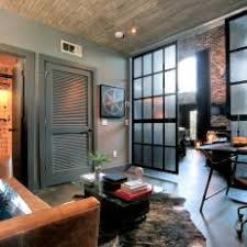 Industrial home office Industrial Chic Rustic Industrial Home Office With Sliding Doors Hgtv Photo Library Rustic Home Office Photos Hgtv