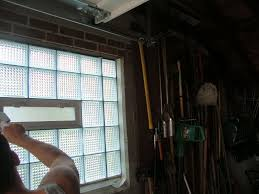 garage windows using glass blocks being mortared for high security and increased privacy