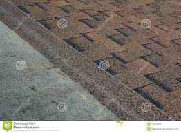 Close Up View On Installing Asphalt Bitumen Roof Shingles