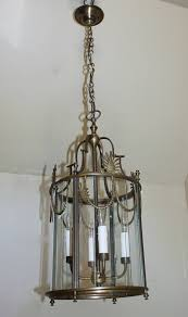 italian brass neoclassic brass hall lantern decorated with swag details at top with segmented glass panels